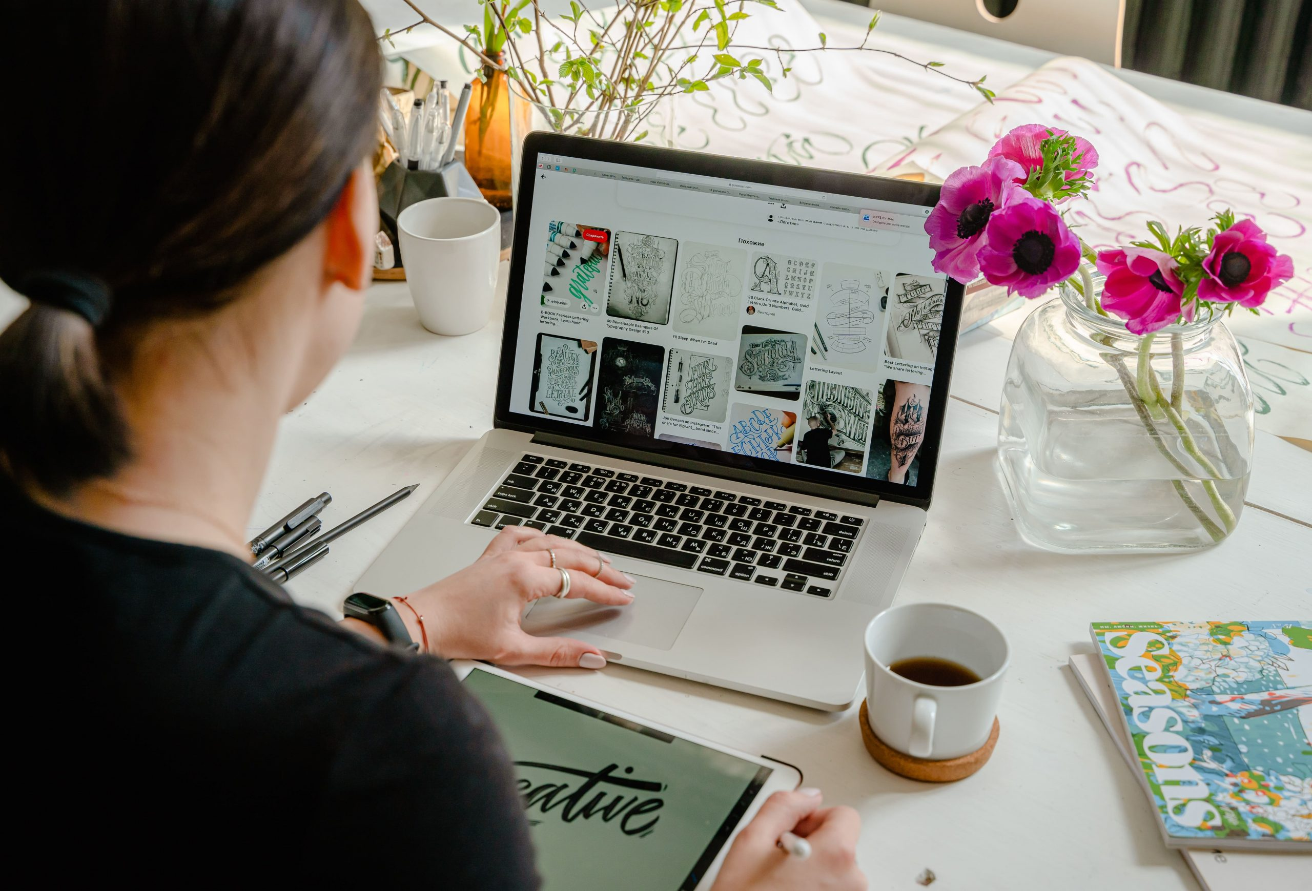 photo of person using laptop for designs