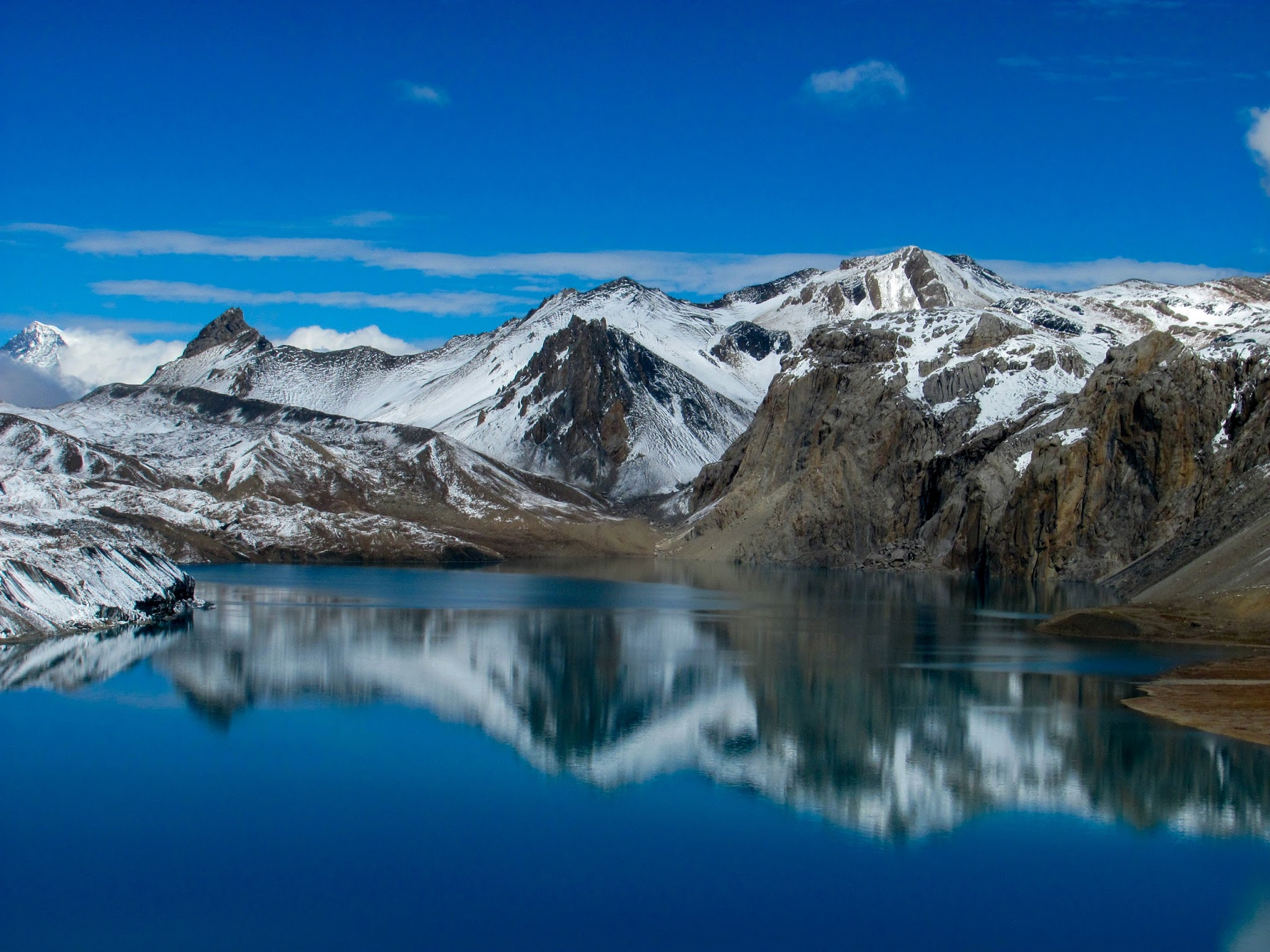 A view of snow cap mountain and lake. Tilicho